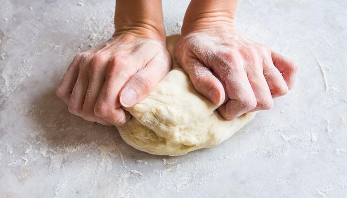 Hands Kneading Pizza Dough.jpg