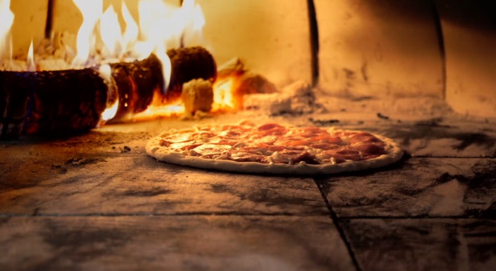 Pizza 101: Tips and Tricks for Using a Wood-Fired Oven [VIDEO]